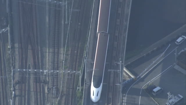 aerial view of a derailed kyushu shinkansen bullet train captured in the morning after a night of earthquakes around 7am 15th april near jr kyushu... - kyushu shinkansen stock videos and b-roll footage