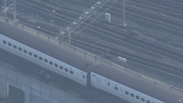 aerial view of a derailed kyushu shinkansen bullet train captured in the morning after a night of earthquakes around 7am 15th april near jr kyushu... - kyushu shinkansen stock videos & royalty-free footage