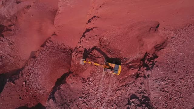 vídeos de stock e filmes b-roll de aerial view of a digger in a quarry, saar valley, rhineland-palatinate, germany, europe - pedreira