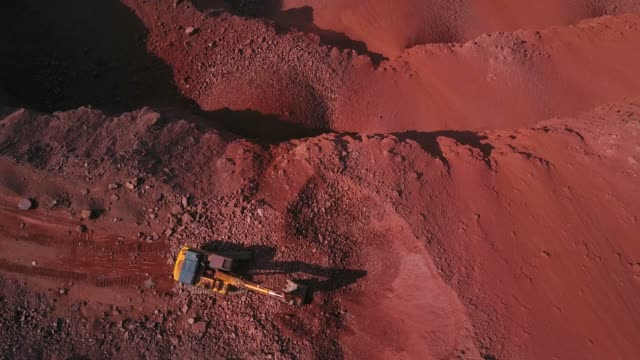 aerial view of a digger in a quarry, saar valley, rhineland-palatinate, germany, europe - valley stock videos & royalty-free footage
