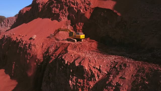 aerial view of a digger in a quarry, saar valley, rhineland-palatinate, germany, europe - quarry stock videos & royalty-free footage