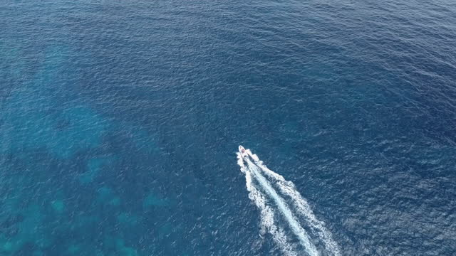 aerial view of a dinghy sailing in the sea - motorboat stock videos & royalty-free footage
