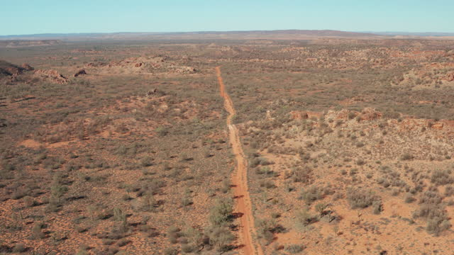 aerial view of a dirt track in the simpson desert - dirt track stock videos & royalty-free footage