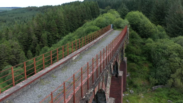 aerial view of a disused railway viaduct in a remote part of south west scotland. - johnfscott stock videos & royalty-free footage