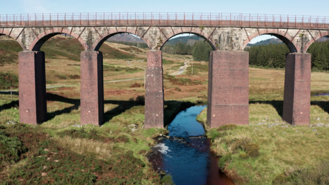 aerial view of a disused viaduct in remote scottish countryside - uncultivated stock videos & royalty-free footage