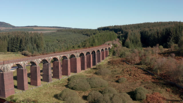 aerial view of a disused viaduct in remote scottish countryside - galloway scotland stock videos & royalty-free footage