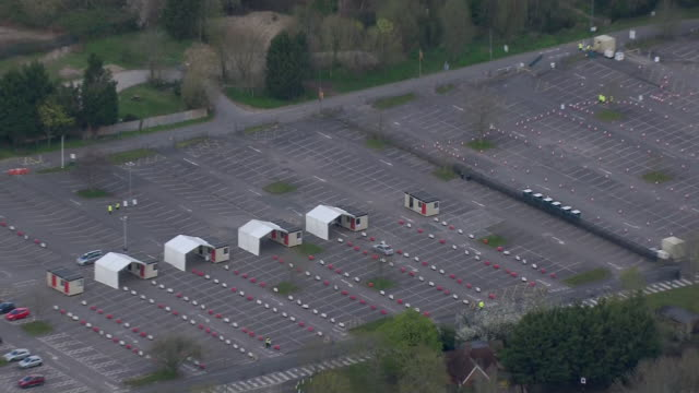 aerial view of a drive-in coronavirus testing station for nhs staff - tent stock videos & royalty-free footage
