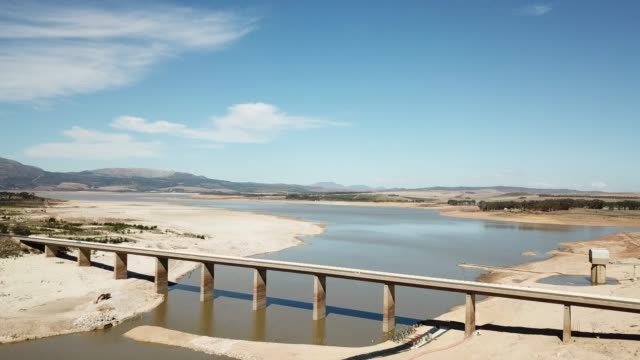 aerial view of a drought-stricken dam in south africa - reservoir stock videos and b-roll footage