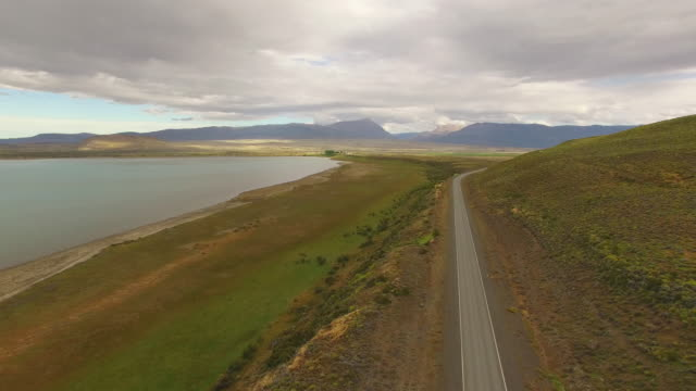 Aerial view of a empty road next a lake at Patagonia, Argentina