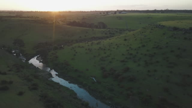 Aerial view of a farm at sunset in Victoria, Australia