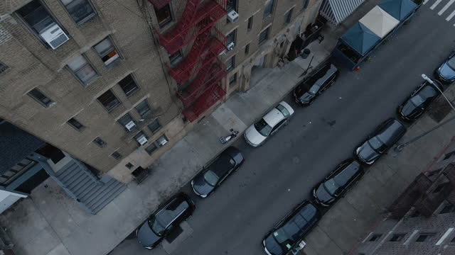 aerial view of a fire escape outside of a brooklyn apartment - moving down stock videos & royalty-free footage