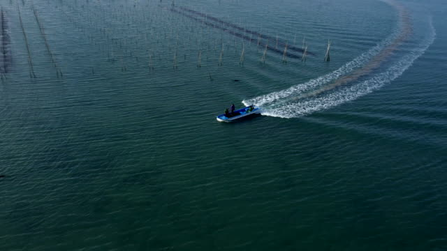 Aerial View of a fishing boat at seaweed farm