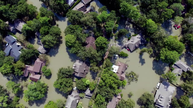 aerial view of a flooded neighborhood from hurricane harvey in houston texas - hurrikan stock-videos und b-roll-filmmaterial