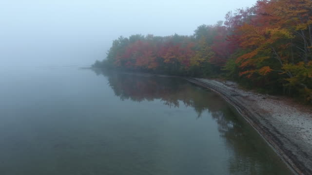 Aerial view of a foggy Lake in fall colours. Orford, New Hampshire. USA