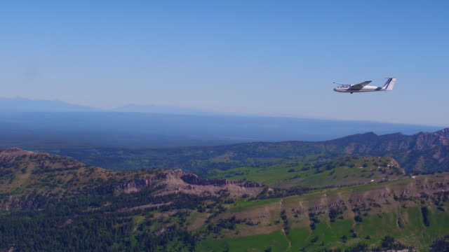 Aerial View of a Glider flying over the mountains