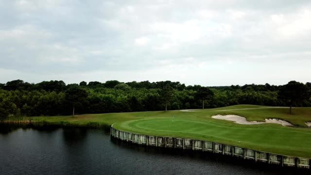 aerial view of a golf course in beaufort, north carolina - golf flag stock videos and b-roll footage