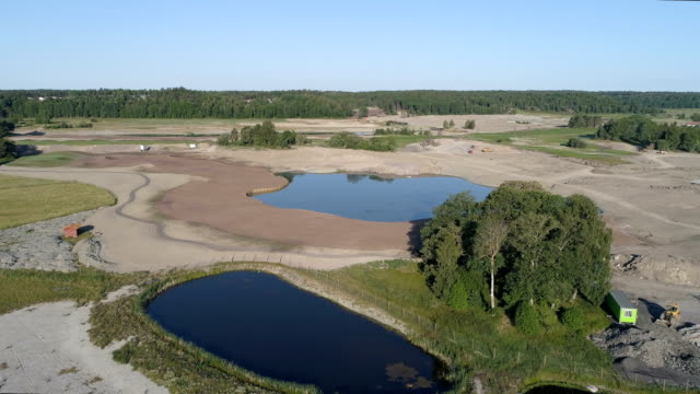 aerial view of a golf course in construction - quarry stock videos and b-roll footage