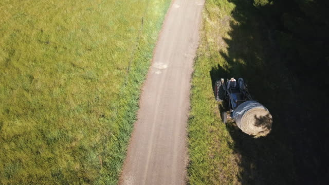 Aerial view of a granny driving a tractor