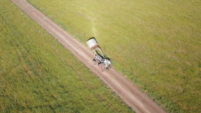 aerial view of a granny driving a tractor - 65 69 years stock videos & royalty-free footage