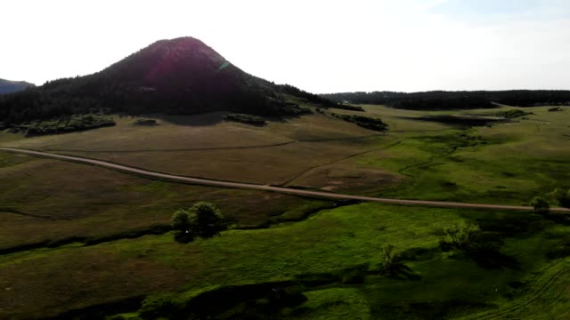 aerial view of a green pasture and a small butte in monument colorado - riverbed stock videos & royalty-free footage
