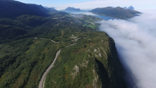 aerial view of a hairpin turn on a cliff beside sea of clouds, Norway