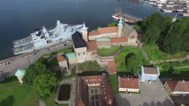 aerial view of a harbor with two warships in oslo - schlossgebäude stock-videos und b-roll-filmmaterial