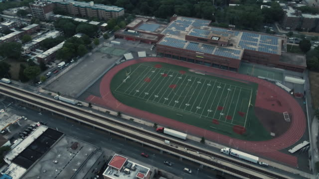 aerial view of a high school football field and track - sports court stock videos & royalty-free footage