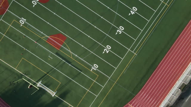 aerial view of a high school football field and track - football pitch stock videos & royalty-free footage