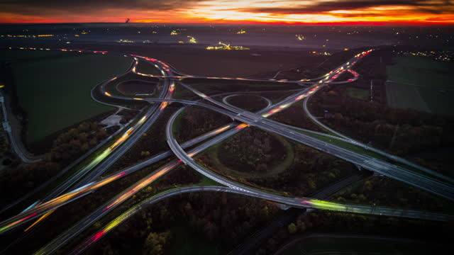 aerial view of a highway intersection - time lapse - light trail stock videos & royalty-free footage