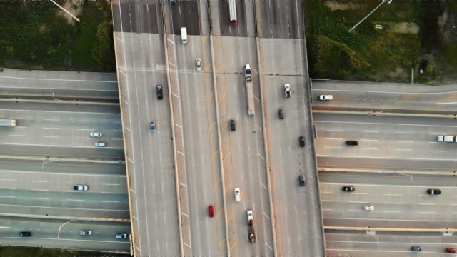 aerial view of a highway intersection - multiple lane highway stock videos & royalty-free footage