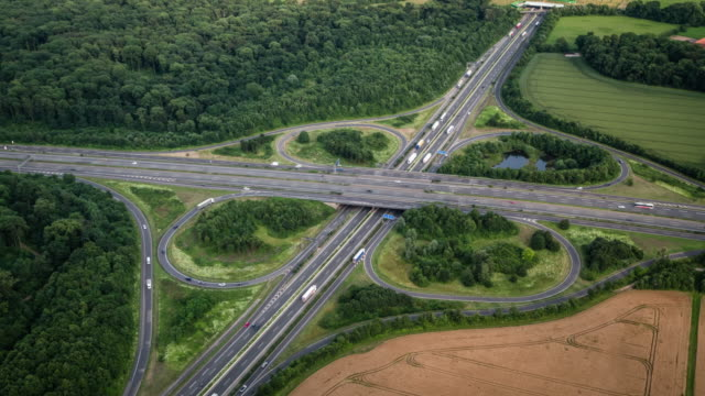 aerial view of a highway intersection - clover leaf shape stock videos and b-roll footage