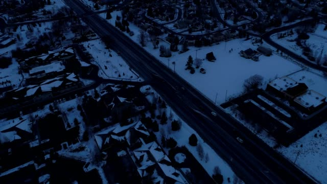 aerial view of a highwya leading up to snowy mountains in park city utah - park city utah video stock e b–roll