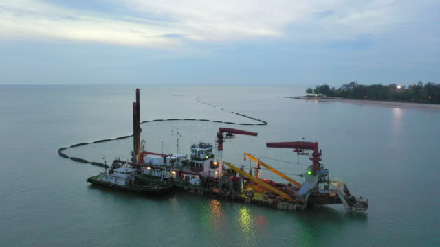 aerial view of a hopper dredge collecting sand from the bottom of the ocean during a beach replenishment project - gravel stock videos & royalty-free footage