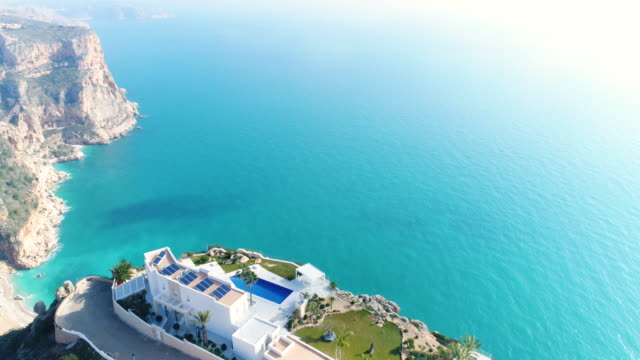 Aerial view of a house on the cliff and seascape in Alicante, Spain