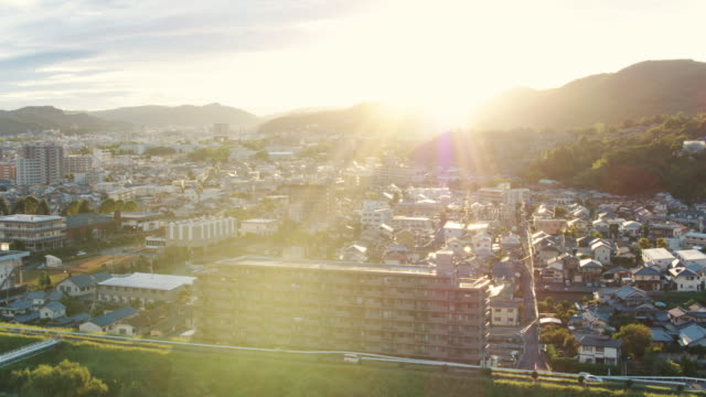 aerial view of a japanese city at sunset - district stock videos & royalty-free footage