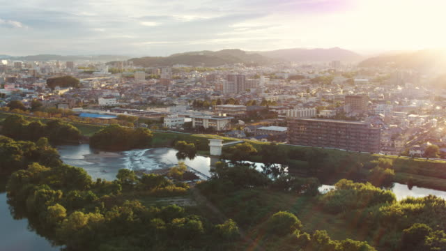 aerial view of a japanese city at sunset - japanese culture stock videos & royalty-free footage