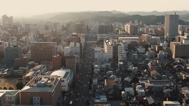 aerial view of a japanese city at sunset - high street stock videos & royalty-free footage