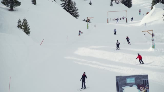 aerial view of a kids slope at la plagne ski resort, tarentaise, savoy, french alps, france, europe - deep snow stock videos & royalty-free footage
