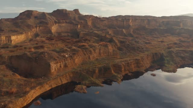 aerial view of a lake and arid landscape - canyon stock videos & royalty-free footage