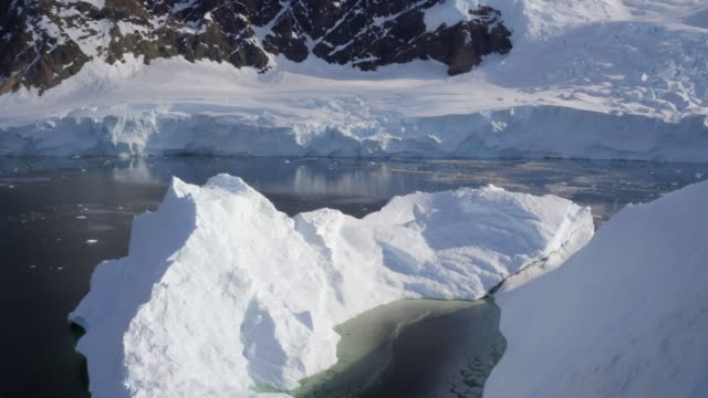 aerial view of a large iceberg in antarctica - water surface stock videos & royalty-free footage