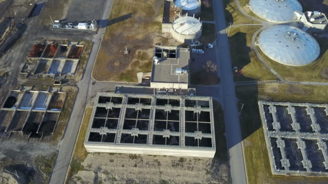 aerial view of a large industrial waste water treatment sewer plant - water purification stock videos and b-roll footage