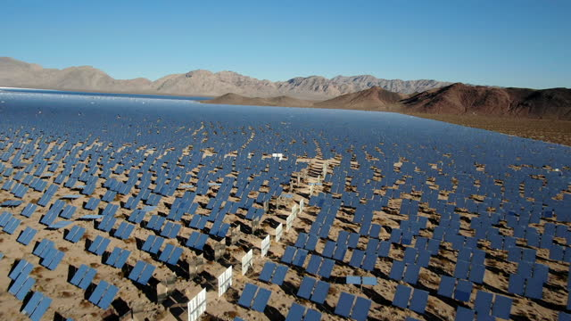 aerial view of a large solar farm in california - nevada stock videos & royalty-free footage