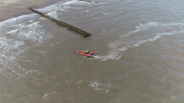 aerial view of a lifeboat and crew off the coast of hornsea - rescue worker stock videos & royalty-free footage