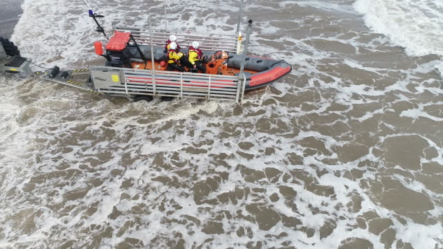 aerial view of a lifeboat being launched into the water off the coast of hornsea - speed boat stock videos & royalty-free footage