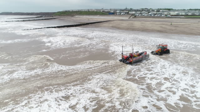 aerial view of a lifeboat returning to land off the coast of hornsea - rescue worker stock videos & royalty-free footage