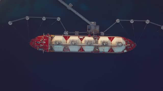 aerial view of a liquefied natural gas (lng) tanker moored to the jetty. oil and gas industry. - pipeline stock videos & royalty-free footage