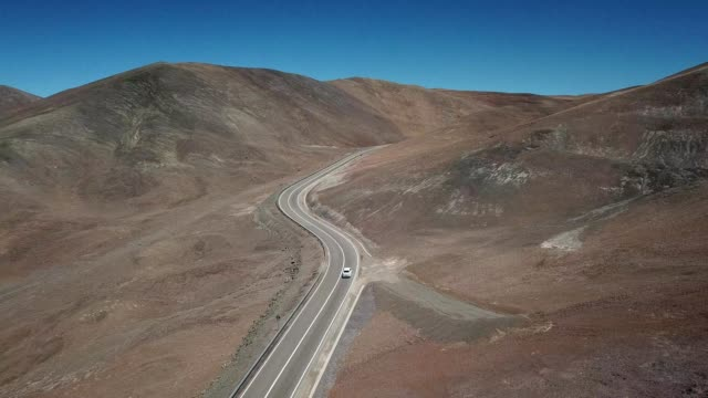 aerial view of a lone road in the desert of antofagasta chile - antofagasta region stock videos and b-roll footage