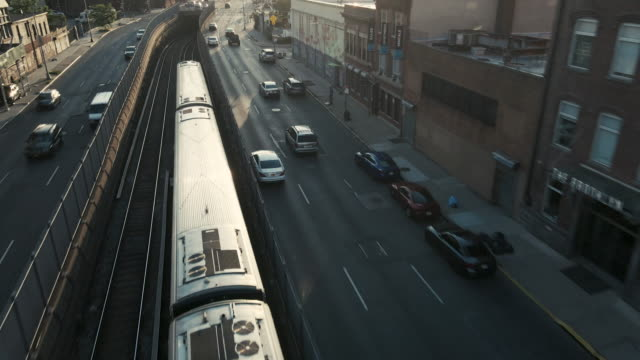 aerial view of a long island railroad train passing through brooklyn. - long island railroad stock videos & royalty-free footage