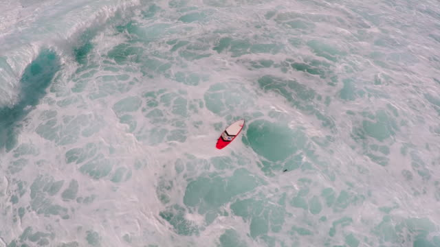 aerial view of a lost surfboard in hawaii. - goodsportvideo stock videos and b-roll footage
