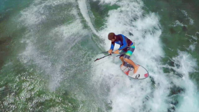 aerial view of a man kitesurfing in hawaii. - slow motion - extreme sports stock videos & royalty-free footage